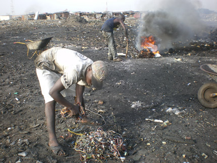 Ghana dumpsite with burning computer wires (Credit: Mike Anana)
